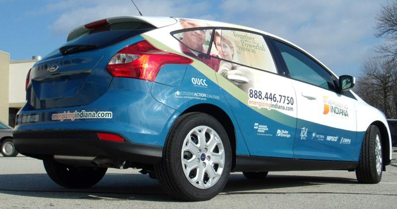 full vehicle wrap, energizing indiana wrap, business vehicle wraps, perf window graphics